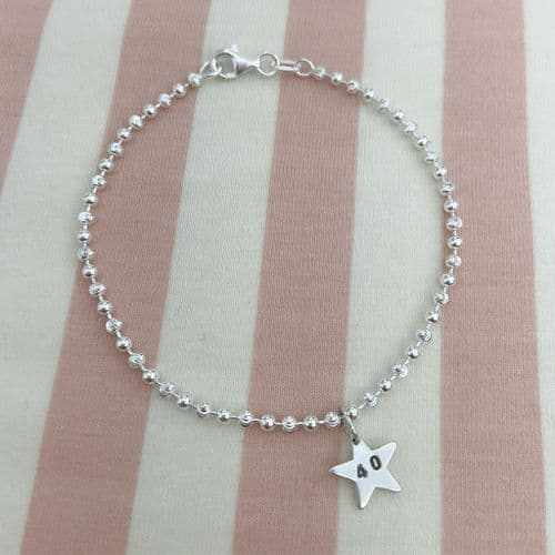 Beaded Silver Bracelet And Star Charm