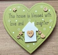'This House Is Blessed With Love And Laughter' Heart Shaped Wooden Hanging Sign....