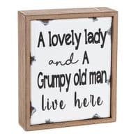 A Lovely Lady And a Grumpy Old Man live Here Old Enamel Plaque