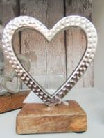 Classic Silver Coloured Hammered Metal Heart On Solid Wood Base...