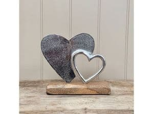 Double Heart Solid And Hollow. Silver Coloured Metal On Solid wood Base...