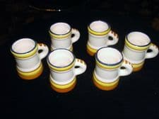 6 X VINTAGE COLLECTABLE MINI TANKARDS ART POTTERY BLUE RIMS ORANGE YELLOW RINGS