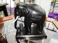 ANTIQUE EBONY CARVED ELEPHANT ON BASE WITH CASE TYRITE SACKS MOOSAJEES CEYLON