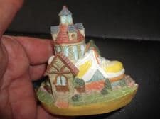 """COLLECTABLE MINIATURE COTTAGE BUILT INTO YELLOW TRAINER SHOE 3"""" HIGH"""