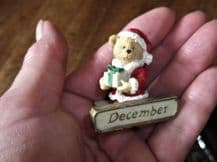 MINI FIGURINE TEDDY BEAR IN SANTA OUTFIT WITH PRESENTS ON DECEMBER PLINTH BASE