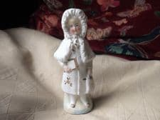 VINTAGE OLD SMALL GILDED FIGURINE VICTORIAN GIRL IN WINTER COAT WITH BAG & BOOK